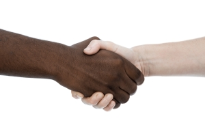 Handshake between african male and caucasian woman